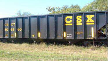 "Orafol R99 Yellow Microprismatic 4"" Conspicuity Tape on railcar. Photo courtesy of Orafol USA."