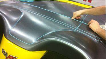 Knifeless Tape being applied to car. Photo courtesy of Knifeless Tech Systems.