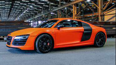 Audi R8 Wrapped in 3M Satin Neon Fluorescent Orange.  Photo courtesy of Lettering Express, OKC, OK.