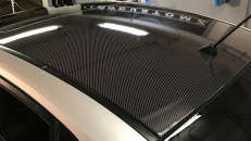 Roof wrapped in 3M IJ180Cv3 High Gloss Deep Black Carbon Fiber by FlowCustomz, Fort Lee, NJ.