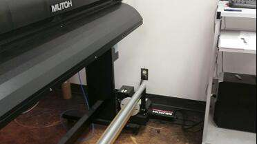 Mutoh Power Filter plugged into Mutoh printer.