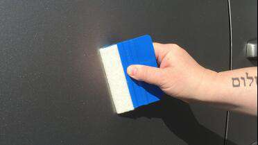Lidco Heavy Duty Felt Edge Squeegee used during car wrap.