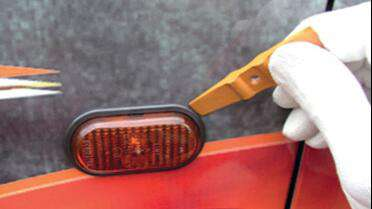 "YelloTools YelloMini Gold 2 3/4"" Squeegee in use. Photo courtesy of YelloTools."