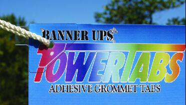 POWERTABS Adhesive Grommet Tabs. Photo courtesy of Banner Ups.