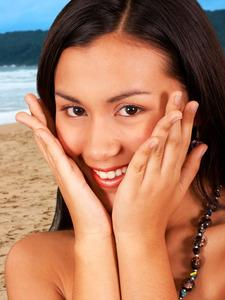 Happy girl standing on the beach f1ratvdd