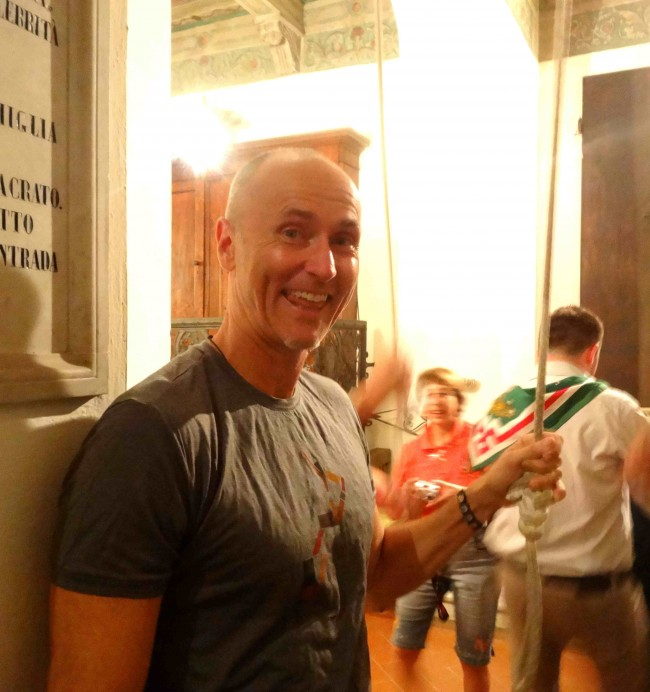 I'm ringing the church bells in the Oca district that helps all of Siena know that Oca won the race