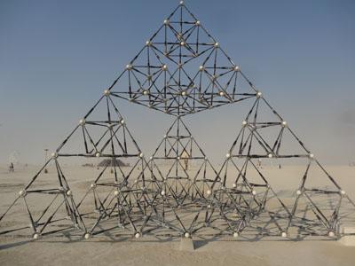 A pyramid made out of baseballs and bats