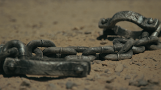 Shackles laying in the dirt thumbnail