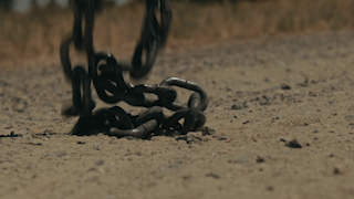 Chains dropping onto the ground thumbnail