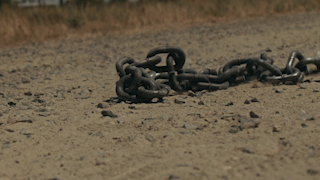 Chains are tossed into the dirt thumbnail