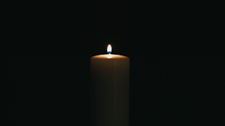 A candle in the dark is blown out thumbnail
