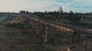 A train bridge runs across an open gorge thumbnail