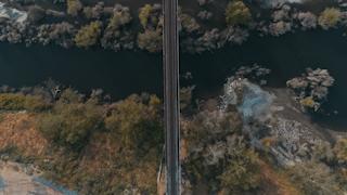 Train tracks run over a river thumbnail