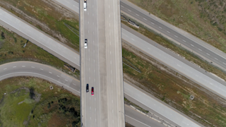 Cars drive over a freeway overpass thumbnail