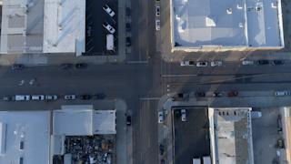 A road runs through empty city streets thumbnail