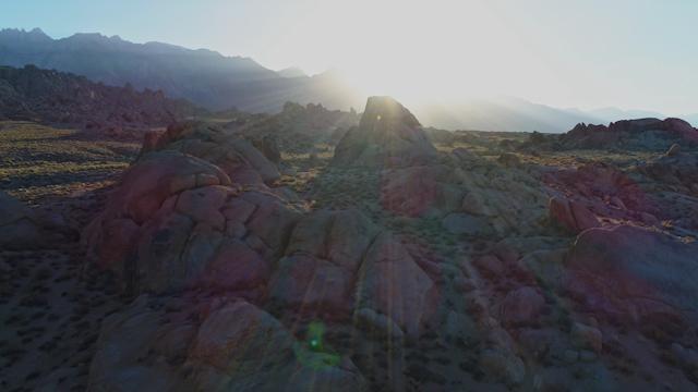 A beautiful rocky terrain at sunset thumbnail