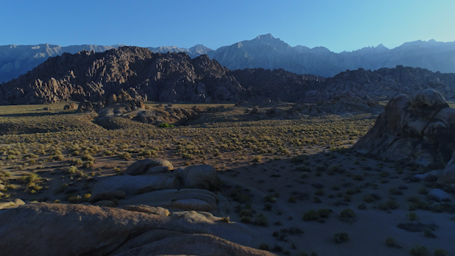 A desert terrain with rocks and mountains thumbnail