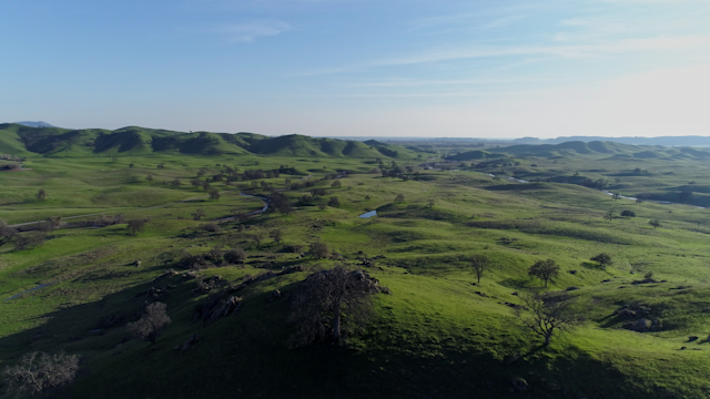 A beautiful green landscape of foothills thumbnail