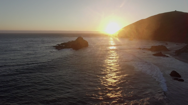 The sun sets over the pacific ocean thumbnail