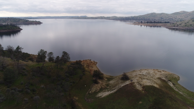 A large lake on an overcast day thumbnail