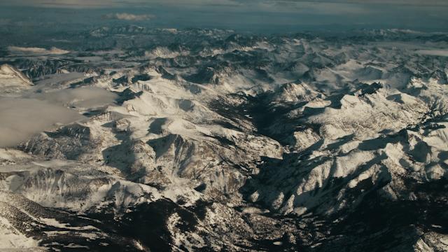 Snow capped mountain range thumbnail