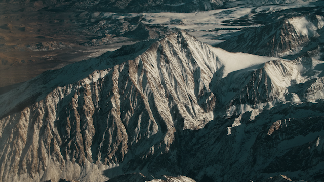 A large snowy mountain is passing by below thumbnail