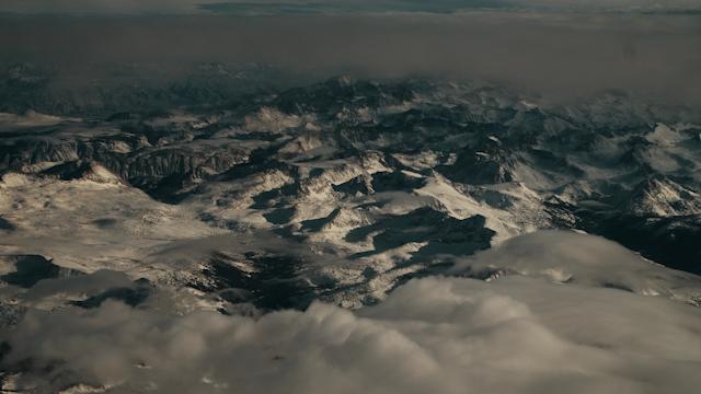 A dark snow capped mountain range thumbnail