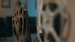 Two old film reels are spinning thumbnail