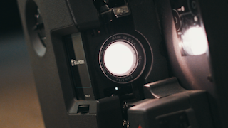 An old film projector flashes it's light thumbnail