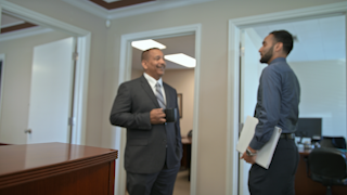 Two businessmen talk with each other in the background thumbnail