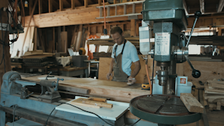 A man works on a project in his workshop thumbnail