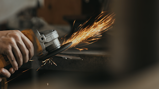 A man is creating sparks with an angle grinder thumbnail