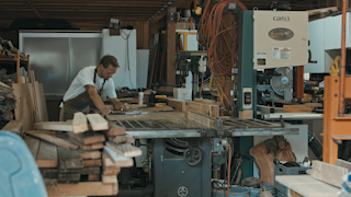 A man is drawing outlines in his workshop thumbnail