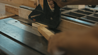 A piece of wood is passed through a table saw thumbnail