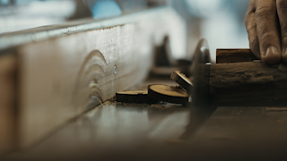 A man cuts small pieces of wood with a table saw thumbnail