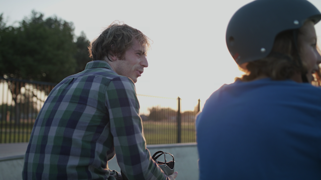 Two skaters are hanging out in a skate park thumbnail