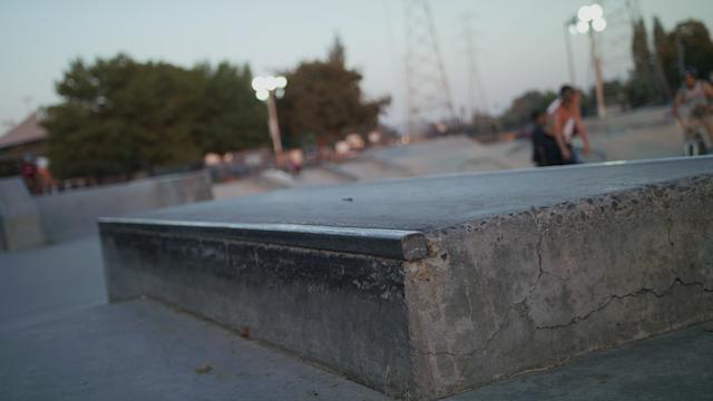 A skater does a manual on a skateboard thumbnail