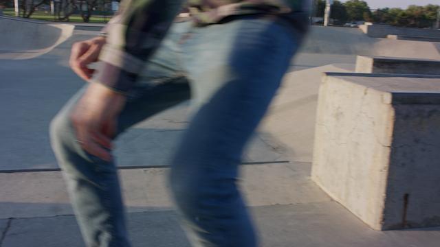 A man is skating around at a skate park thumbnail