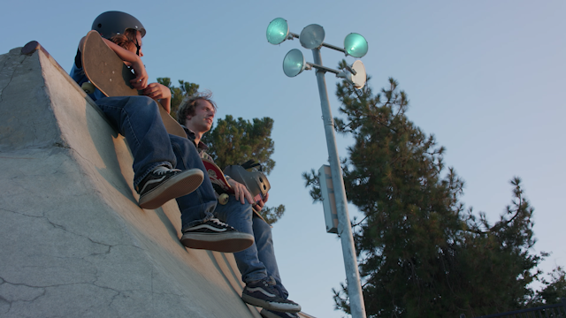 Two skaters are sitting on a half pipe thumbnail