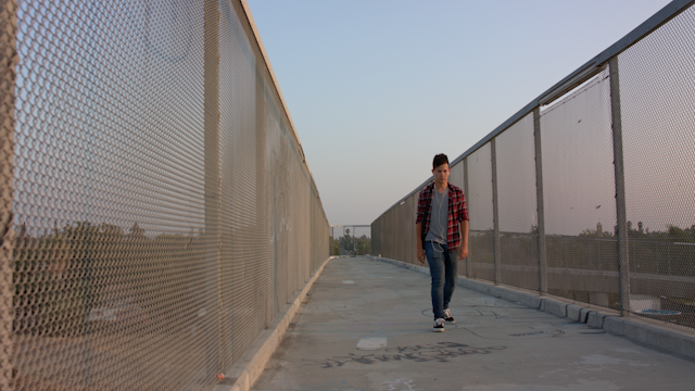 A teenager is walking down an overpass while listening to music thumbnail