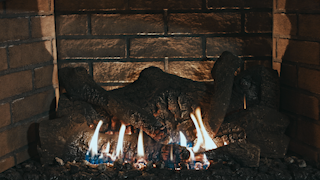 A fire burns in a fireplace thumbnail