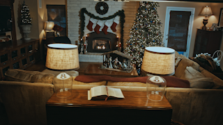 A cozy family room is decorated for christmas thumbnail
