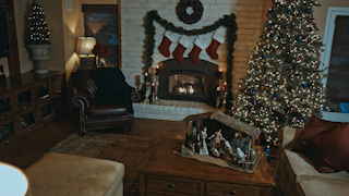 A family room is decorated for christmas thumbnail