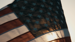 American flag waving at sunset thumbnail
