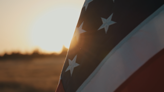 American flag stars and stripes at sunset thumbnail