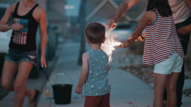 Kids and their parents are lighting sparklers thumbnail