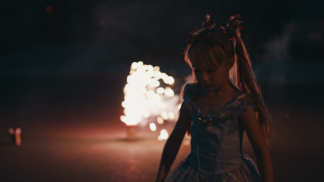 A little girl is watching fireworks thumbnail