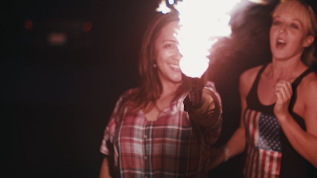 Two women are holding a huge sparkler thumbnail