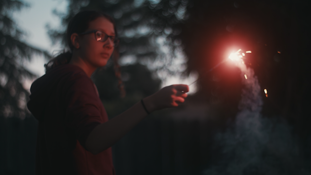 A girl spins around with a sparkler thumbnail