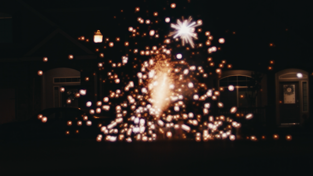 Sparks are shooting in the air and onto the ground thumbnail